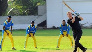 David Cameron bats against Sri Lanka's Muttiah Muralitharan
