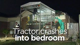 Tractor crashes into bedroom, injures sleeping couple