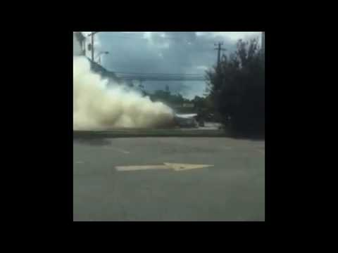 VIDEO: Car Catches Fire at Intersection in Rome