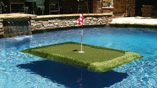 https://www.thegrommet.com/floating-golf-greensSwing on down to the pool to practice your swing. This Made in the USA floating golf green sits atop water like an island, extending the course of your game. Made from super-durable, recycled, synthetic turf, it's equipped with a flag, cup, turfed chipping pad, and a dozen floating golf balls. Hone your golf skills by transforming your yard into a putting station. Whether you're perfecting your own technique, or using the turf to entertain guests, everyone will want a swing at it.