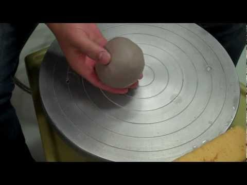 center - An instructional demonstration on how to center one pound of clay, on the potters wheel.