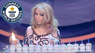Video Most birthday candles lit with the feet in one minute - Guinness World Records MP3, 3GP, MP4, WEBM, AVI, FLV Mei 2017