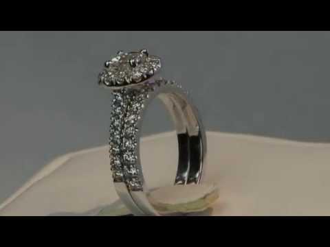 halo style diamond engagement ring and matching wedding band