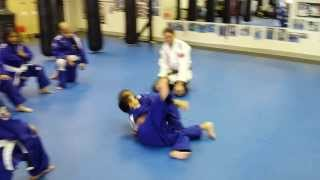 Juniors teach hook flip in Jiu-Jitsu