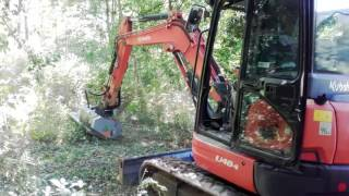 Mise en service d'un broyeur forestier FAE à marteaux mobiles PMM/HY 125 (1.25m de largeur de rotor) sur pelle KUBOTA 4.8...