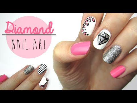 Nail - A nail art design featuring a big, sparkly diamond! Today's nail art design is a mix and match style featuring leopard print, a diamond, lots of glitter, and pink! It's a very girly nail art...