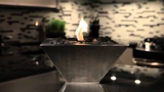 Anywhere Fireplace Empire 90295 Bio-Ethanol Fireplace features contemporary stainless steel with polished black rocks design...