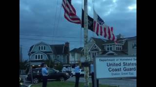 Taking down the flags at the USCG station at Great Egg Harbor