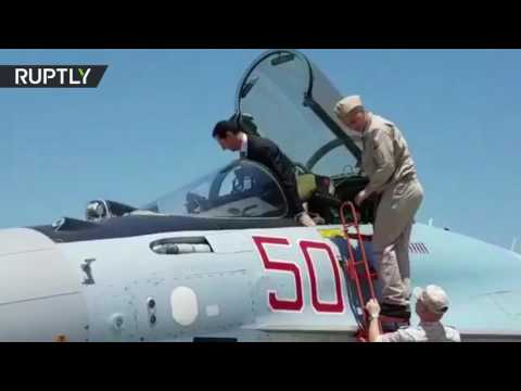 Assad tries out role of Su-35 fighter jet pilot at Russia's Khmeymim airbase