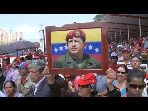 celebrates - One year after Hugo Chavez's death, Venezuelans are still divided on how they view him.