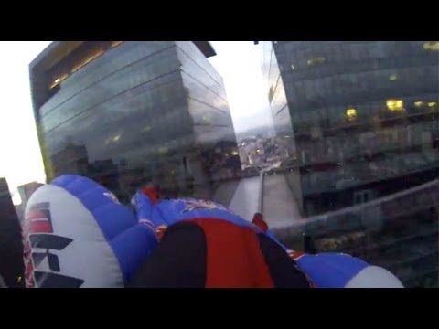 Wingsuit flying between two buildings