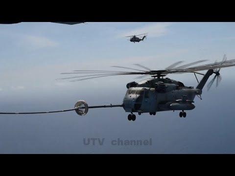 Marine C-130 refuels a CH-53 mid...
