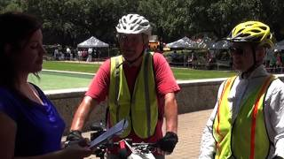 Houston Poet Laureate, Gwendolyn Zepeda, peddles FREE POETRY to a couple traveling on bicycles around the farmer's market.