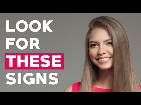 9 Body Language Signs She's Attracted to You