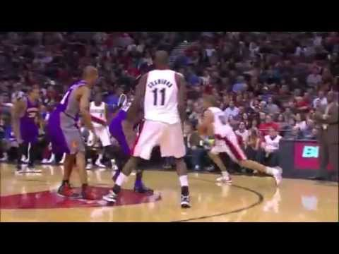 Nicolas Batum dunks over Jared Dudley