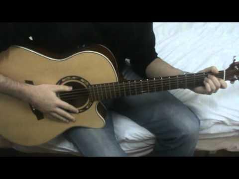 Cómo tocar acordes con ritmo en guitarra