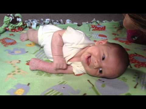 Teaching baby to roll over