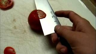 Super Sharp Knife Cutting a Tomato
