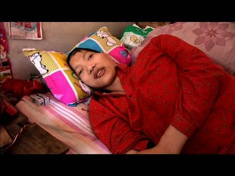 defen - The world's tallest woman, Yao Defen, is prematurely discharged from hospital after recovering from a life threatening fall. With the odds stacked against he...