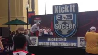 Orange crushers soccer team doing their cheer on the stage before they receive their trophy at the 3v3 kick it tournament at the...