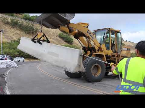 UDOT Workers Place Concrete Barrier In Elk Ridge, Utah
