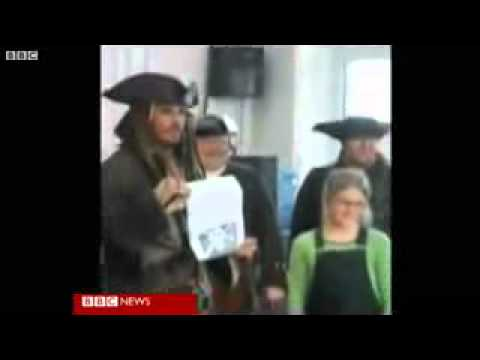 Johnny Depp visits a greenwich school in london.