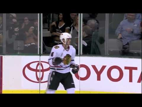 NHL: Jamie Benn Checks Niklas Hjalmarsson Into Glass 10/7/11      - YouTube