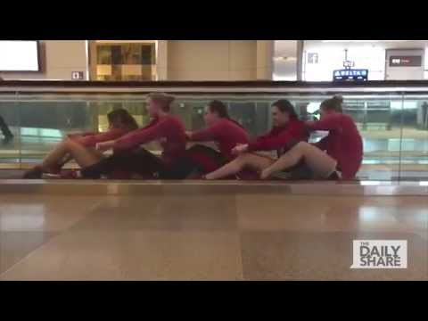 Hilarious swim team has fun at the airport видео