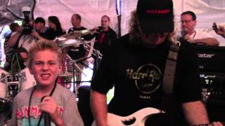 Devin was asked to join Nicko McBrain (Iron Maiden's drummer) & his band, The McBrainiacs for an awesome performance of...