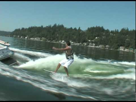 Mark riding behind a Centurion on Inland Surfer board