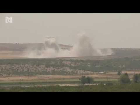 Explosions rock Syrian border as Turkey presses operation