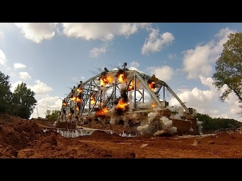 A Bridge Is Imploded In Slow Motion