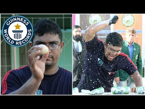 World Record for Crushing Cans While Holding an Uncooked Egg