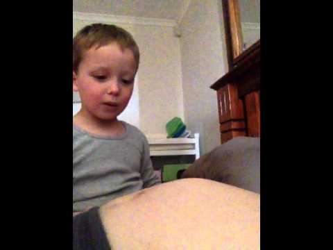 2 yr old watching baby move in belly
