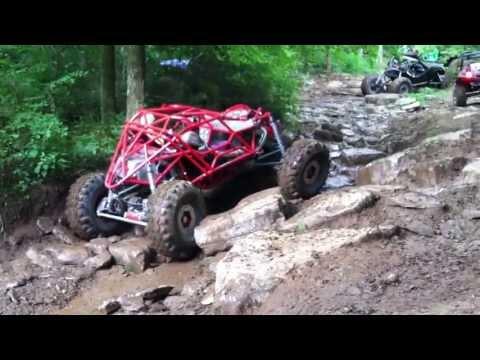 Custom Rock Crawler Buggy Tearing Up A Creek Bed
