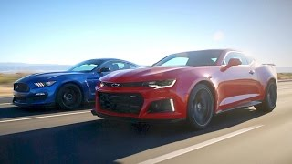 The battle between super muscle cars has reached a fever pitch. Watch as KBB's Micah Muzio and Zach Vlasuk pit the Ford Mustang Shelby GT350 and Chevrolet Camaro ZL1 against one another on both the street and track. KBB is your source for new car reviews, auto show coverage, features, and comparison tests. Subscribe to catch all the latest Kelley Blue Book videos. http://www.youtube.com/subscription_center?add_user=kbb