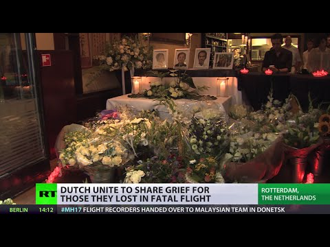 tribute - Devastated relatives of MH17 plane crash victims mourn after one of the deadliest plane crashes in Dutch history. Remains will arrive in the Netherlands on Wednesday. In the meantime people...
