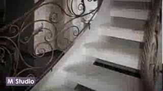 Монолитная  лестница одетая в  мрамор