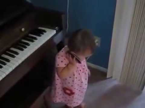 What's the deal? Who knows what the heck this kid is saying, but by golly - She MEANS It:
