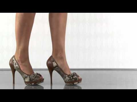 multiple heels and shoes - To purchase please visit: http://www.heels.com/womens-shoes/sanura-nat-multi-ll.html Feel like a temptress in these snake inspired pumps from Guess. Sanura h...