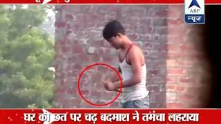 Uttar Pradesh: Thug scares away police with a 'desi' gun