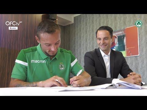 The signing of Eric Bautheac for Omonia with agent Gregoire Akcelrod
