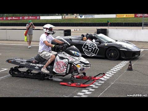 Snowmobile races vs. Ferrari 458 and F430 Spider