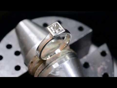 Princess white sapphire bezel set engagement ring