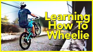 I'm beyond stoked to say that I can finally wheelie my MTB!! I still can't wheelie super duper well, but I can definitely wheelie my bike semi consistently. If you've been following Skills with Phil for any length of time, you'll know that I suck wheelies . Learning to wheelie over the past few months has been a struggle but very recently I have made some big progress. In this wheelie update video I share what I've discovered over the past few months of practice.SUBSCRIBE ▶︎ https://goo.gl/xu5U0hPatreon Community ▶︎ https://goo.gl/8SHpPFFrequently asked questionsWhat bike/gear do I use ▶︎ https://goo.gl/9LrYtRInstagram ▶︎ https://www.instagram.com/philkmetz/Facebook ▶︎ https://www.Facebook.com/philkmetz/Most Recent ▶︎ https://goo.gl/10Kw6d8 Simple MTB Tricks ▶︎ https://www.youtube.com/watch?v=Uuyn7A1Yb8A&list=PLKhb73W7eMRH_Ov7BeDivctjXAD2bTsOJ&index=18 Fun MTB Tricks ▶︎ https://www.youtube.com/watch?Walmart Bike Torture Test ▶︎ https://youtu.be/wkMnk_eCDQU?list=PLKhb73W7eMREOqKUAP4u-qXKzvgUy0zGWEvil Calling ▶︎ https://www.youtube.com/watch?v=5irX8yVn0uw&list=PLKhb73W7eMREOqKUAP4u-qXKzvgUy0zGW&index=2