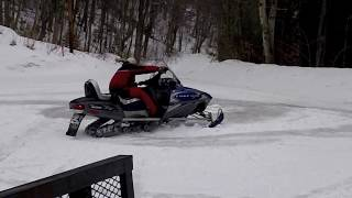 6. Donuts on Polaris Edge Touring 600 Snowmobile Before Hitting the Trail