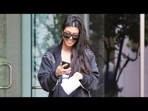 Kourtney Kardashian Flashes A Smile When Asked If Kim Is Pregnant Again