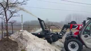 10. Manitou MLT625 with Snow Blower Attachment