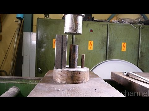 Crushing metal pipes with hydraulic press