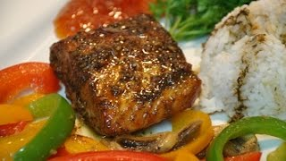 How to cook awesome baked honey garlic salmon. This tasty salmon recipe is oven baked and topped with a honey garlic sauce.